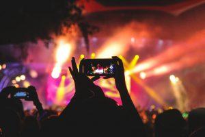 taking photo at concert as social validation